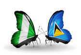 Butterflies with Nigeria and Saint Lucia flags on wings — Stock Photo