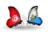 翼にチュニジアとサンマリノのフラグと蝶 — ストック写真
