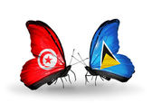 Butterflies with Tunisia and Saint Lucia flags on wings — Stock Photo