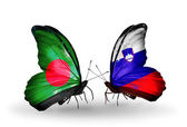 Butterflies with Bangladesh and Slovenia flags on wings — Stock Photo