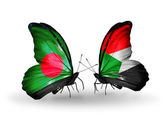 Butterflies with Bangladesh and Sudan flags on wings — Stock Photo