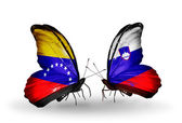 Butterflies with Venezuela and Slovenia flags on wings — Stock Photo