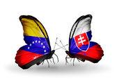 翼にベネズエラとスロバキア フラグと蝶 — ストック写真