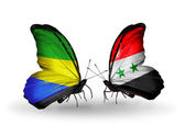 Butterflies with Gabon and Syria flags on wings — Stock Photo