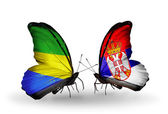 Butterflies with Gabon and Serbia flags on wings — Stock Photo