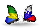 翼にガボンとスロベニアのフラグと蝶 — ストック写真