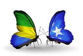 翼にガボンとソマリアのフラグと蝶 — ストック写真