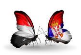 Butterflies with Yemen and Serbia flags on wings — Stock Photo