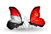 Butterflies with Yemen and Soviet Union flags on wings — Stock Photo