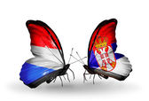 Butterflies with Luxembourg and Serbia  flags on wings — 图库照片