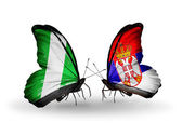 Butterflies with Nigeria and Serbia flags on wings — Stock Photo