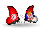 Butterflies with Tunisia and Serbia flags on wings — Stock Photo