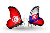 Butterflies with Tunisia and Slovakia flags on wings — Stock Photo