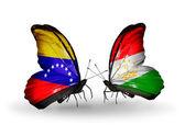 Motyle z wenezueli i tadżykistan flagi na skrzydłach — Zdjęcie stockowe