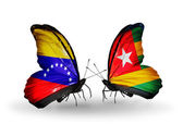 Butterflies with Venezuela and  Togo flags on wings — Stock Photo