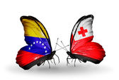 Butterflies with Venezuela and Tonga flags on wings — Stock Photo