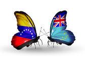 Butterflies with Venezuela and Tuvalu flags on wings — Zdjęcie stockowe