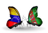 Butterflies with Venezuela and Turkmenistan flags on wings — Stock Photo