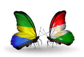 Butterflies with Gabon and Tajikistan flags on wings — Stock Photo