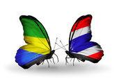 Motyle z gabonu i tajlandia flagi na skrzydłach — Zdjęcie stockowe