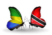 Butterflies with Gabon and Trinidad and Tobago flags on wings — Zdjęcie stockowe