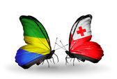 Butterflies with Gabon and Tonga flags on wings — Stock Photo