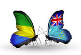 Butterflies with Gabon and Tuvalu flags on wings — Stock Photo