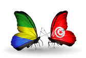 Butterflies with Gabon and Tunisia flags on wings — Zdjęcie stockowe