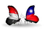 Butterflies with Yemen and Taiwan flags on wings — Stock Photo