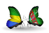 Butterflies with Gabon and Turkmenistan flags on wings — Stock Photo