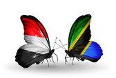 Motyle z jemenu i tanzanii flagi na skrzydłach — Zdjęcie stockowe