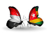 Butterflies with Yemen and Togo flags on wings — Stock Photo