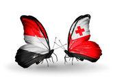 Borboletas com bandeiras iêmen e tonga sobre asas — Fotografia Stock