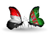 Butterflies with Yemen and Turkmenistan flags on wings — Zdjęcie stockowe
