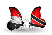 Butterflies with Yemen and Trinidad and Tobago flags on wings — Stock Photo