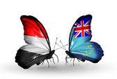 Motyle z jemenu i tuvalu flagi na skrzydłach — Zdjęcie stockowe