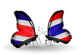 Butterflies with Costa Rica and  Thailand flags on wings — Stock Photo