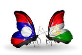 Butterflies with Laos and  Tajikistan flags on wings — Stock Photo