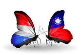Butterflies with Luxembourg and  Taiwan flags on wings — Stock Photo