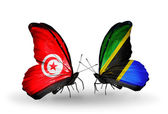 Butterflies with Tunisia and Tanzania flags on wings — Stock Photo