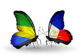 Butterflies with Gabon and Philippines flags on wings — Stok fotoğraf
