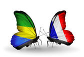 Butterflies with Gabon and France flags on wings — Stok fotoğraf
