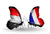 Butterflies with Yemen and France flags on wings — Stok fotoğraf