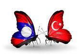 Laos ve türkiye bayrakları kanatlar üzerinde kelebekler — Stok fotoğraf