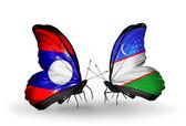 Kelebek kanatları üzerinde laos ve özbekistan'a bayraklı — Stok fotoğraf