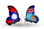 Butterflies with Laos and Fiji flags on wings — Stok fotoğraf