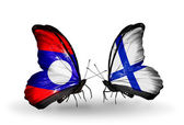 Butterflies with Laos and Finland flags on wings — Stok fotoğraf