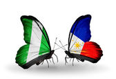 Butterflies with Nigeria and Philippines flags on wings — Stok fotoğraf