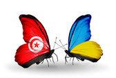 Butterflies with Tunisia  and Ukraine flags on wings — Stok fotoğraf