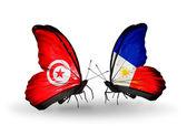 Kelebek kanatları üzerinde tunus ve türkiye bayraklı — Stok fotoğraf